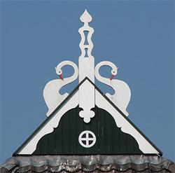 fríský ulebord s apolinskými labutěmi a kížem v kruhu